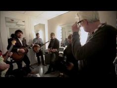 """Wilco, Nick Lowe & Mavis Staples rehearse """"The Weight"""" backstage at the Civic Opera House in Chicago in December 2011. Filmed by Zoran Orlic."""