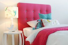 Tufted headboard is cute - may be nice in black with hot pink buttons on the bright pink wall with the framed pics and adjectives
