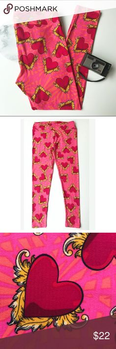 LuLaRoe T/C Tall & Curvy Leggings Pink Red Hearts LuLaRoe T/C Tall & Curvy Leggings with a fun winged heart print. Perfect for Valentines, an anniversary, date night, or anytime! Pink and Red with yellow accents. Excellent condition, no flaws. (Inventory J18). LuLaRoe Pants Leggings