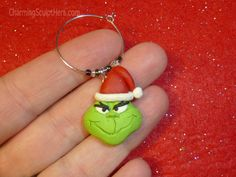 Dr Seuss The Grinch polymer clay wine glass charm.  For more information please visit www.CharmingSculptHers.com