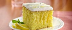 When life hands you lemons, make lemonade cake! This moist lemon cake drizzled and filled with an easy lemon filling will remind you of summer any time of year.