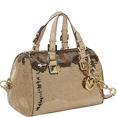 $369.99-$368.00 Shimmering Suntan sequins cover this gorgeous Medium Grayson Sequin Satchel from Michael Kors.  Vachetta leather handles for hand held wear plus a removable/adjustable chain link and leather strap for a cross body look.  Zips open to a Michael Kors logo lined center with side slip and zip pockets.  Gold tone hardware including a large MK logo charm hangtag. A nice medium size bag a ...