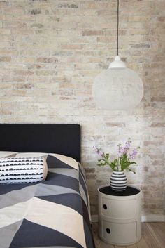 Bedroom wall with stone wallpaper