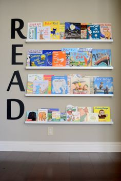 "We are still loving the library wall in the nursery and this ""READ"" sign from @spottedzebras is perfection!"