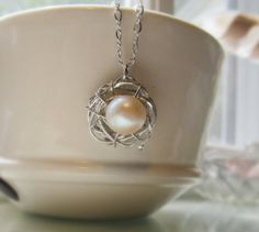 Handmade silver and pearl nest pendant necklace. Abstract nest series. Unique jewelry. Fashion jewelry.
