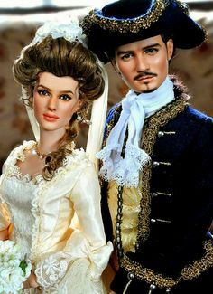 "Elizabeth Swann and Will Turner played by Keira Knightly and Orlando Bloom from the movie ""Pirates Of The Caribbean: The Curse Of The Black Pearl""."