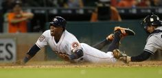 Houston Astros third baseman Luis Valbuena (18) is tagged out at home plate by New York Yankees catcher John Ryan Murphy (66) in the eighth inning of an MLB game at Minute Maid Park on Thursday, June 25, 2015, in Houston.  ( Karen Warren / Houston Chronicle )