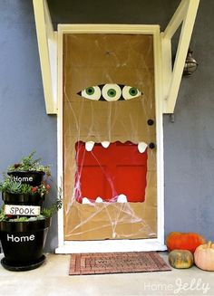 Paper bag door monster with paper plate eyes! Fun how-to included...