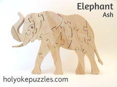 Rompecabezas de elefante con ojos de Swarovski por HolyokePuzzles