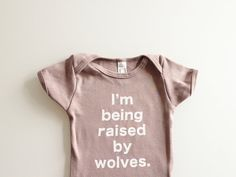 Baby onesie I'm Being Raised By Wolves 36mo by eggagogo on Etsy, $18.00