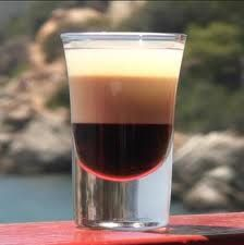 The Orgasm Cocktail Shot (2 parts Baileys, 1 Part Amaretto,  1 part Kahlua, fill with cream).