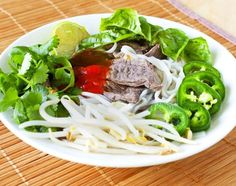 Pho is one of my favorite soups simply because the broth is so flavorful. A while ago I made Pho Ga which is the same soup only made with chicken. Then I went to a local Pho restaurant and the beef pho was just fantastic and I knew I had to try the beef version as well. The pho is seasoned with