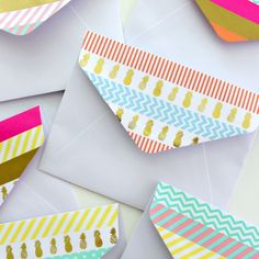 Add a rainbow of colour to plain, white envelopes with washi tape!