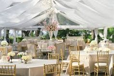 tent wedding decor: This light-and-airy look with minimal decoration (gold chivari chairs, one major centerpiece in a silver urn) is ideal for a daytime wedding. Tent Wedding, Budget Wedding, Wedding Table, Wedding Planning, Wedding Ideas, Wedding Blog, Wedding Receptions, Chic Wedding, Wedding Trends