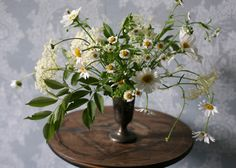 Wildflower centerpiece. Its so whimsical with the highs and lows. #centerpiece
