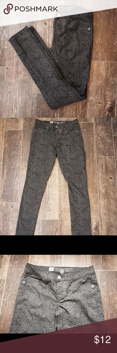 NWOT Premium Denim Leggings Waist about 14in across 28in around Length about 39 inches Size 4 stretchy material  These are super cute and fun leggings. Dark gray snakeskin pattern. They are a reposh because they don't fit me. The previous seller said they were New without tags. I just tried them on and didn't wear them so still considering them NWOT. Bundle in my closet and save! Mossimo Supply Co. Jeans Straight Leg