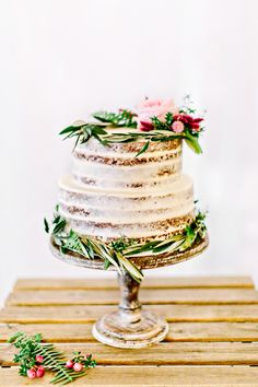 A sweet and simple naked cake: http://www.stylemepretty.com/2016/03/15/bachelor-wedding-ben-higgins-lauren-bushnell-mindy-weiss/