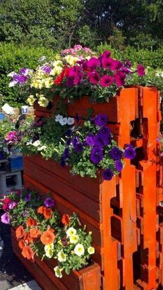 Make an upright garden to show off plants, Cut and paint a few pallets and turn them upright. Then, install a plastic liner with small nails or a staple gun to keep the soil in.