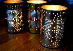 Candle holders made from food cans. Poke any design you want!