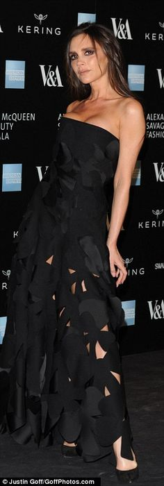 Dramatic: The star, who struck her tradmark pose, looked stunning in her elegant strapless...