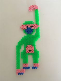 Kaj Bojesen abe i grøn farve, lavet ud af perler.