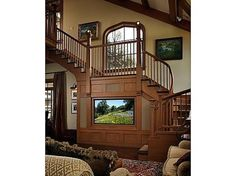 Andie MacDowell's tudor style fairy tale home. . . living room view of stair case