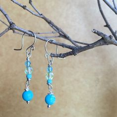A personal favorite from my Etsy shop https://www.etsy.com/listing/253118726/turquoise-blue-and-green-dangle-earrings