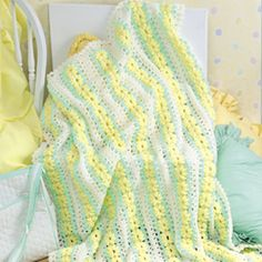 Leisure Arts - Darling Daisies Wrap Crochet Pattern ePattern, $4.99 (http://www.leisurearts.com/products/darling-daisies-wrap-crochet-pattern-digital-download.html)