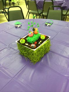 This is our table centerpiece.  My friend melody made the cake pops.  Everything on the plate is edible except for the trees stem.  The big grass is a brownies. We use green royal icing for the grass. The trees leaves are made of fondant.  The soil are oreo cookies.  The lady bugs are candy pinata.  The rest ate cake pops (without the stick).
