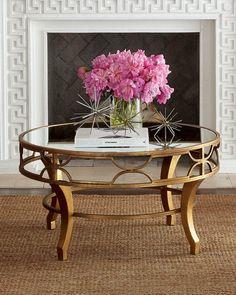 """<ul> <li>Mirrored coffee table with fretwork apron.</li> <li>Made of metal and mirrored glass.</li> <li>Antiqued-gold finish.</li> <li>36""""Dia. x 19""""T.</li> <li>Imported.</li> </ul>"""