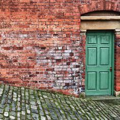 red brick, green door... time to give the house a face lift.