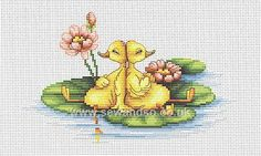 Ducklings on a lilypad