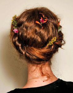This tousled floral-adorned hair crown would be amazing at your next music festival. #hairstyle #beauty #boho #flowercrown