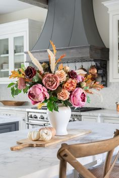 Create your own stunning fall flower arrangement with high-quality silk flowers from Afloral. Simply choose your favorite fall-toned blooms and style in a ginger jar. Shop this look by @sanctuaryhomedecor at Afloral.com.