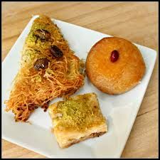 Have you tried Turkish food? Chicken Kabob in Stoughton offers more than kebabs: stuffed grape leaves, grilled whole fish, and these de. Stuffed Grape Leaves, Chicken Kabobs, Sweet Pastries, Turkish Recipes, Cake Decorating, Chicken Recipes, Pineapple, Grilling, Fruit