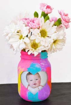 25 Mason Jar Presents for Mother's Day- Mother's Day Gifts-FOR THE MOM WHO LOVES COLOR-This colorful craft is the perfect gift that everyone will love. Make one with a snap of the kids for mom...then make another for grandma.Get the tutorial at I Heart Arts N Crafts. Find more Mother's Day arts and crafts ideas for kids at redbookmag.com.