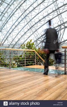 Businessman in hurry, motion blurred people over office building Stock Photo