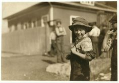 Charlie Foster has a steady job in the Merrimack Mills. School Record says he is now ten years old. His father told me that he could not read, and still he is putting him into the mill. Lewis Hine, December 1913.