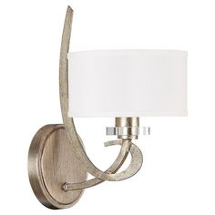 Featuring a sleek scrolling design and winter gold finish, this captivating wall sconce lends contemporary elegance to your dining room or master suite.