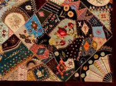 This extraordinary Victorian Crazy Quilt has the most elaborate embroidery I have seen. The center is a Japanese fan with the figure of a ge...