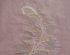 Paloma Silk Embroidered Fabric Mauve silk fabric with silver and gold embroidered floral design.