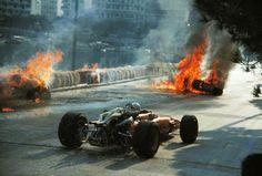 Chris Amon navigates his way through the wreckage of Lorenzo Bandini's Ferrari, Monaco 1967