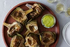 Tarragon-Lemon Aioli Served with Grilled Artichokes - These smoky, bewitching artichoke cross-sections are an ideal kickoff to any warm weather supper.