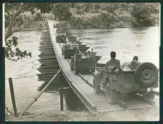 """""""This Fine Photo features American Jeeps as they pass over a US PONTOON BRIDGE in the New Guinea Jungle during WORLD WAR II, the troops are loaded with military supplies as they advance toward their ALLIES to aid against the fight with the JAPANESE."""""""