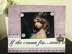 "If the Crown Fits...Wear It princess royalty jeweled gift handmade magnetic picture frame holds 5"" x 7"" photo 9"" x 11"" size. My frames are magnetic backed, covered with beautiful paper, and come with 3 embellished magnets. All frames are 9 x 11 and have a velvet easel back for free standing display or can be hung by a beautiful attached ribbon. Each frame is great for 1 to 3 pictures, notes, or recipes. You can put your pictures, notes or recipes where ever you want and then change them…"
