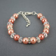 """8mm shade of coral glass pearls, 8mm clear - $11.70 I'm not in love with it, and it might be too big for us (7"""")."""