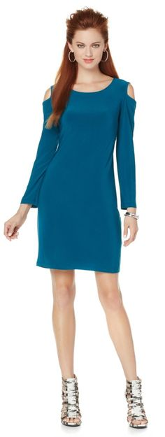 """Give ordinary dresses the """"cold shoulder"""" when wearing this elegant long-sleeve jersey dress! Designed with sexy cutout detail, this dress gives you the right to bare arms! Dress things up by pairing this with your favorite heels, or dress it down with a great boot or bootie!"""