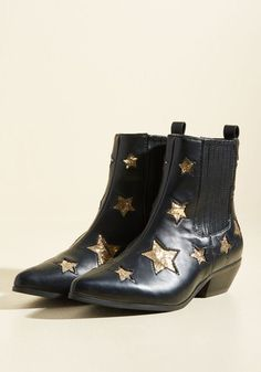 Wishing to make your day the best one possible? Each glittery gold star on these black faux-leather boots provides you with the chance to make that dream come true. Plus, their paneled sides, block heels, and pointed toes pack your look with a sweet celeb vibe, sure to gain you a legion of fashion fans!