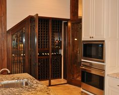 Wine Cellar under stairs with doors