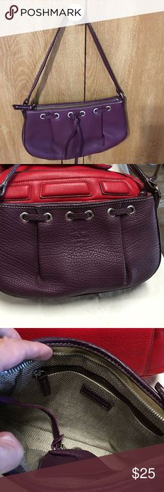Dooney & Burke purse Beautiful purple leather Dooney & Burke purse.  Clean, no smell, no tear & wear. Tiny scratches shown on the bottom but you can't even hardly tell. This purse would be perfect for a night out with friends. #1 fun of Dooney & Burke accessories. 😊 Dooney & Bourke Bags Mini Bags